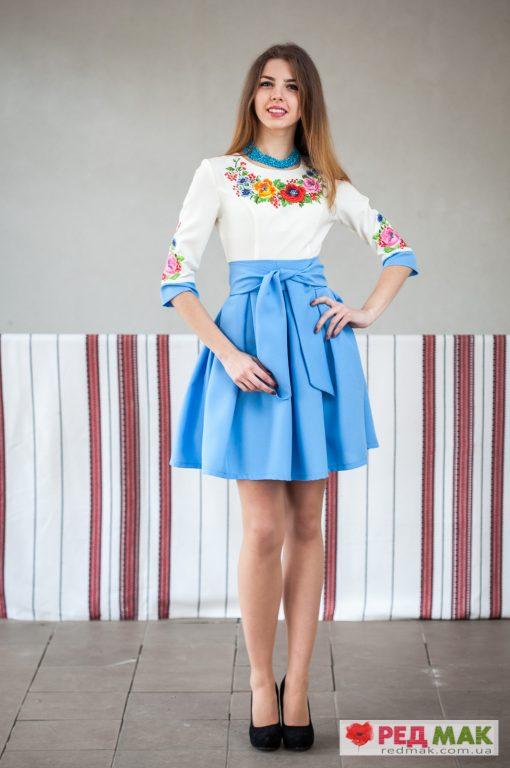 Блакитне плаття з кишенями