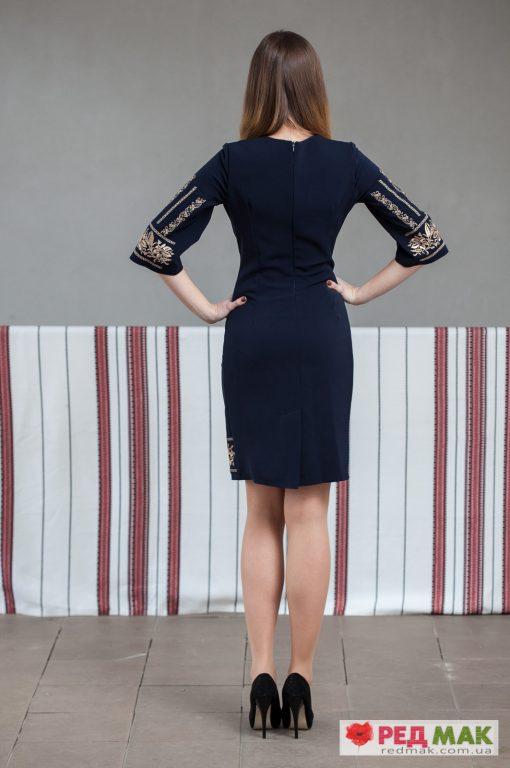 Темно-синє плаття оздоблене вишивкою гладдю та хрестиком
